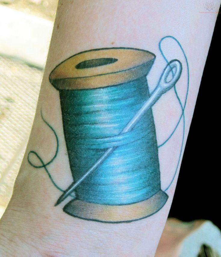 Thread spools tattoo blue thread spool and needle tattoo for Sewing needle tattoo