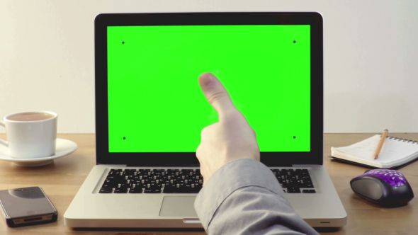 Download Free              Using Laptop with a Green Screen               (Stock Footage)            #               chroma key #computer #desktop #display #green screen #internet business #laptop #notebook #presentation #screen #show #startup #thumb up #using mouse #workplace
