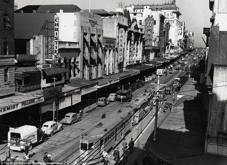 Queen Street, 1953: Until the late 1960s, trams ran along the entire length of Queen Street and cars could be parked in the main street of Brisbane. Buildings on the left included Christies Café, Tattersall's Club, Bayards, His Majesty's Theatre, Wintergarden Theatre (WGT), and T&G Mutual Life Society Building