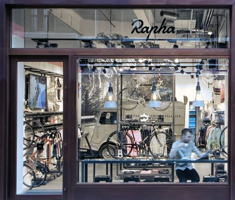 Rapha Cycle Club by Brinkworth - coffee shop + cycle gear retail store where cyclists can hang bikes on the walls while they shop