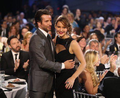 Bradley Cooper hugs Jennifer Lawrence at the Critics Awards 2013