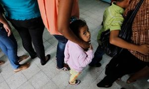 Women and their children wait in line to register at the Honduran Center for Returned Migrants after being deported from Mexico, in San Pedro Sula, northern Honduras June 20, 2014. Thousands of young people are hoping to reach the U.S. from their impoverished and violent homes in Central America. In the eight months ended June 15, the U.S. has detained about 52,000 children at the Mexican border, double the figure the year earlier. There is no telling how many have gotten through. Picture…