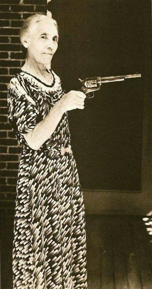 Pat Garrett's wife, holding the gun he used to kill Billy the Kid
