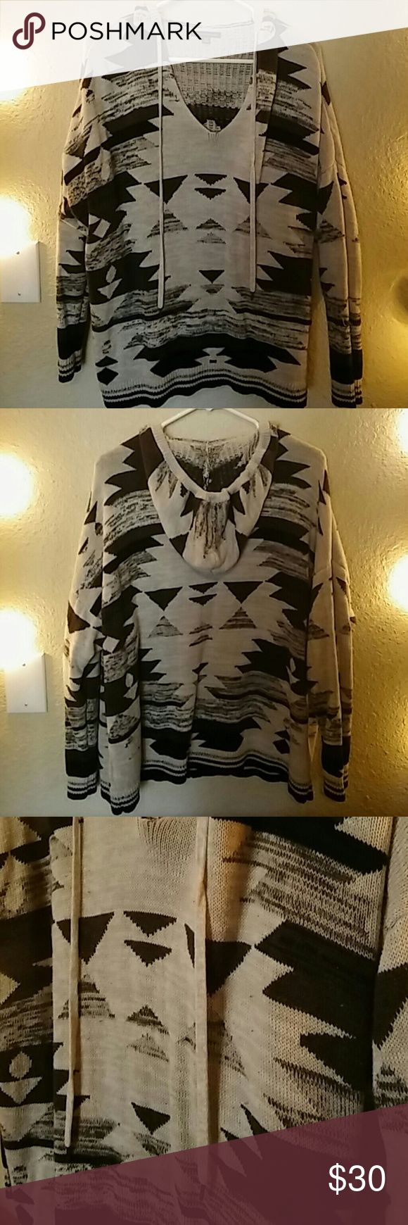 American Eagle Tribal Print Sweater EUC. Size XL. American Eagle black, gray, oatmeal tribal print sweater. This oversized 100% cotton knit poncho sweater with hoodie will keep you warm this winter. Excellent condition, no rips, holes, or stains. Make me an offer. American Eagle Outfitters Sweaters Shrugs & Ponchos