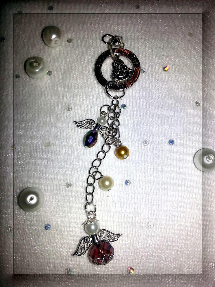 """Hängsmycke ring """"Wish"""" med en liten Buddha i mitten och två änglar, ca. 12 cm"""