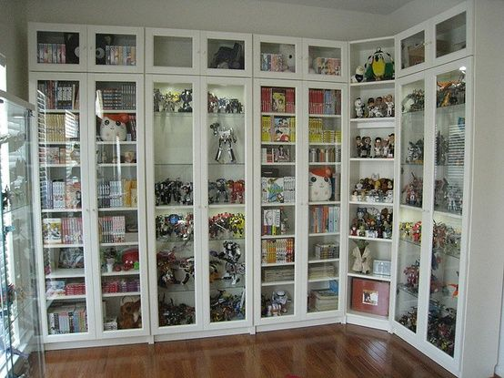Billy bookcases from IKEA, with height extensions and glass doors. This is  what you