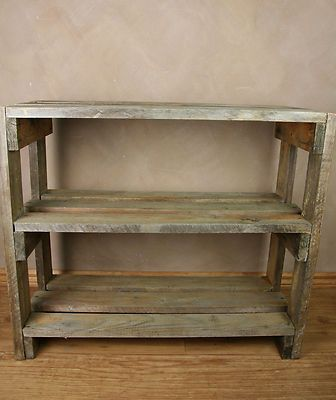 Recycled pallets could be modified and made into a potting and storage space for the garden.