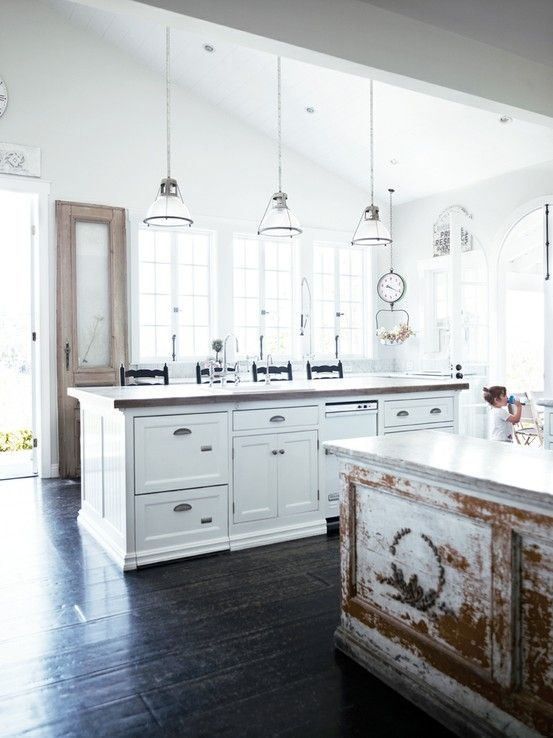 Dark floor with white walls  Love the rustic cabinet