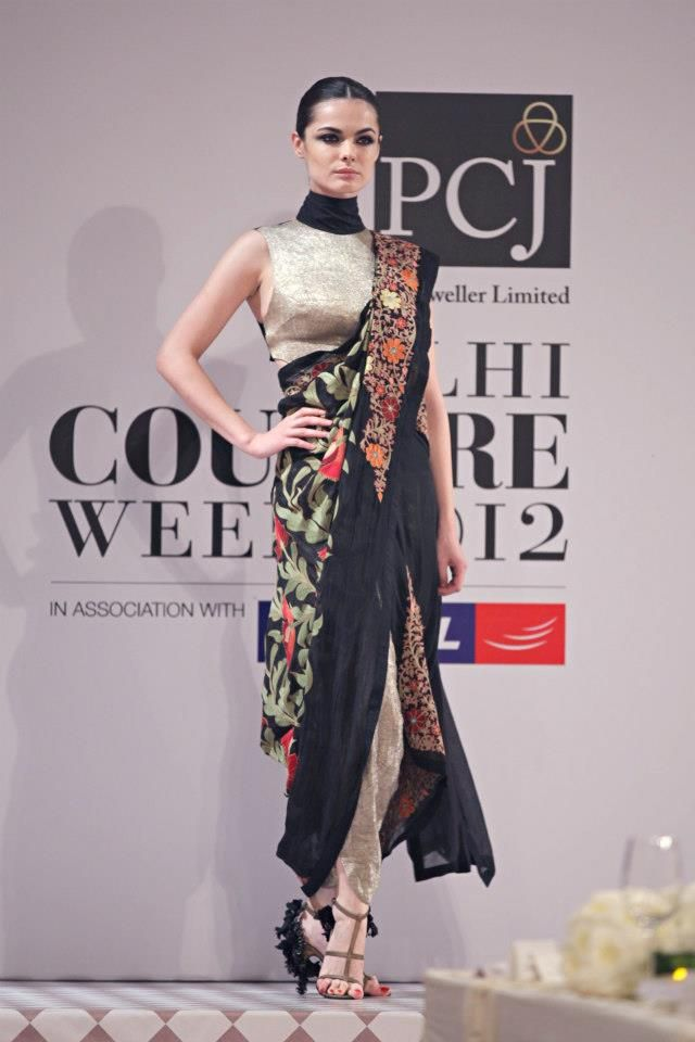 """PHOTO CREDIT: FDCI  After seeing these images, Anamika Khanna is way up on my wish list even  though I don't really wear Indian clothes. The designer presented her  latest line called """"A love song to India"""" at PCJ Delhi Couture Week 2012.  Soft colors offset with the hue less black.E"""
