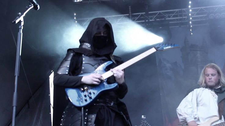 Twilight Force ⚫ Filmed by Lockefall Media Group ⚫ Sabaton Open Air 2014 ⚫ #TwilightForce #music #metal #concert #gig #musician #Chrileon #Lynd #DeAzsh #Born #Blackwald #Aerendir #singer #vocalist #frontman #guitarist #guitar #microphone #ninja #mask #armour #armor #microphone #bracers #tattoo #beard #hood #elf #tabard #playing #coat #earrings #leather #blond #longhair #festival #photo #fantasy #magic #cosplay #larp #man #onstage #live #celebrity #band #artist #performing #Sweden #Swedish…