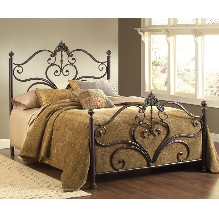 Metal scrolls form hearts topped with ornate fleur-de-lis in the headboard and footboard of the Newton bed, an ideal centerpiece for your boudoir. The Victorian four-poster design comes in a set complete with rails and assembly hardware.