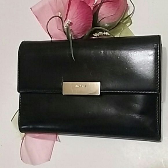Auth.Prada Wallet Authentic Black Prada Wallet..Unisex Wallet Excellent.. gently used. This wallet has been stored for several years. It time for me to let go of this beauty.  Please ask questions Leather is in excellent condition. Great Condition. 100% Authentic. Price is firm *Fight like a girl* Prada Bags Wallets