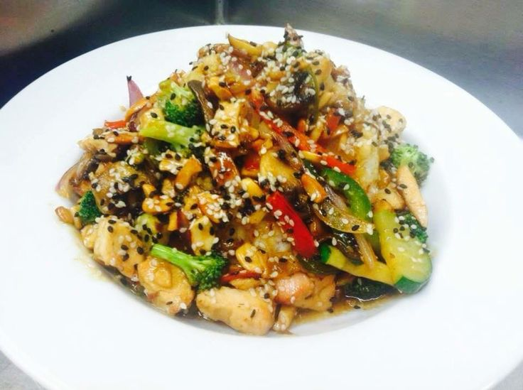 CHICKEN CASHEW STIR FRY:  FRESH grilled chicken breast & fresh veggies sautéed in our homemade kalbi sauce (Korean teriyaki), served over a bed of fragrant jasmine rice, topped with cashews and sesame seeds. $10 *Add homemade soup or salad for $2