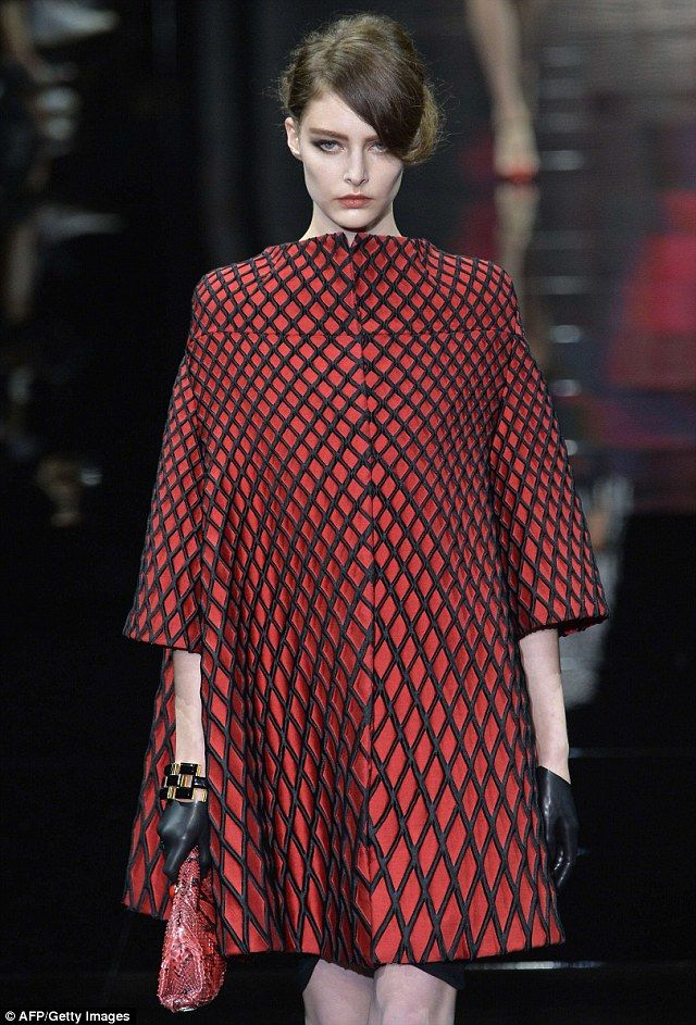 Lady in red: The Armani models strutted down the runway in a plethora of red and black designs, accessorizing with black latex gloves and snakeskin clutches