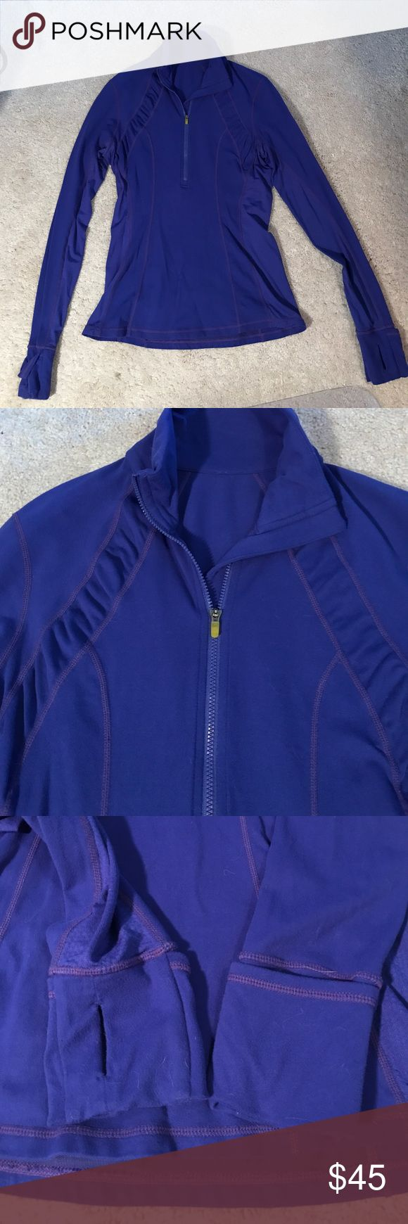"""Lululemon run energy pullover Lululemon rum energy pullover. Size 8. Wish blue. Older (""""vintage"""") lululemon, meaning softer fabric and great quality. This is a thinner top and runs a bit small for an 8. Would fit a 6 or 8 well. Form fitting. Half zip in the front and a zip pocket on the pack. Cuffs have thumb holes and cuffins. Comes from a non smoking, cat friendly home. lululemon athletica Tops Tees - Long Sleeve"""
