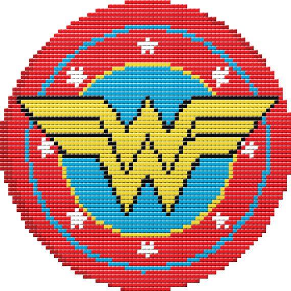 Hey, j'ai trouvé ce super article sur Etsy, chez https://www.etsy.com/fr/listing/287369181/wonder-woman-shield-cross-stitch-pattern