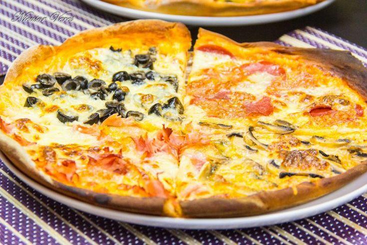 pentru inceput de weekend va invit la o felie de Pizza Quattro Stagioni.Pentru inceput preparam aluatul, reteta pentru aluat o puteti gasi aici : aluat pentru pizza.