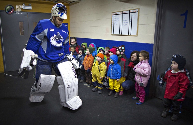 A group of pre-school children watch as Vancouver Canucks goalie Luongo leaves the dressing room during a team informal practice in Vancouver.