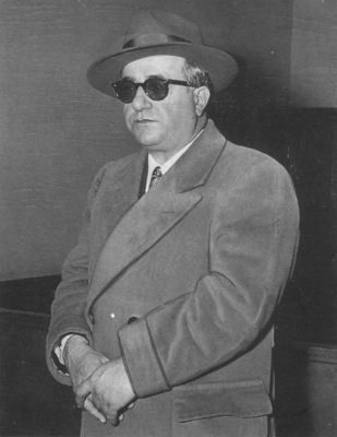 Albert Anastasia. Was the worst murderer EVER. Thankfully he got wacked in New Yorks Park Sheraton hotel in October 1957. The hotel is still there. The barber shop is currently a Starbucks! Shame he made it to 55 years old. A lot of innocent folks died at his direction.