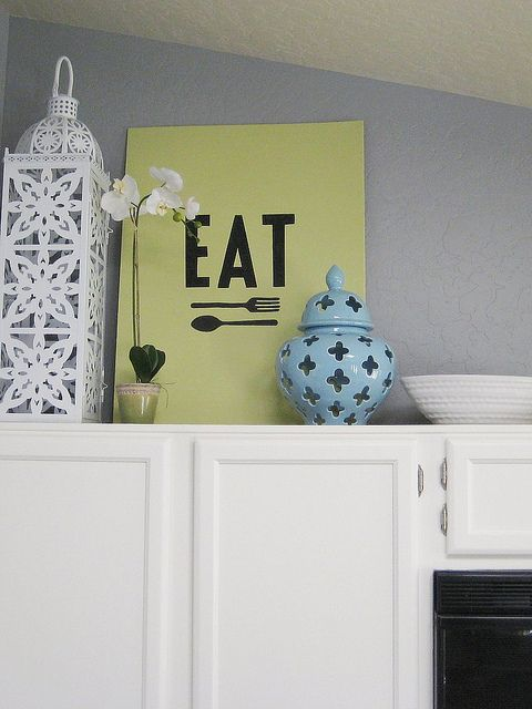 This is what I did for another client on top of her kitchen cabinets, just another idea...