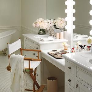 InStyle Magazine - bathrooms - master bathroom, master bath ideas, lauren conrad, lauren conrads home, his and her vanities, his and her washstands, white marble countertops, oval sinks, hook and spout faucets, drop down vanity, make up vanity, drop down make up vanity, dressing table, drop down dressing table, lit vanity mirror, hollywood style vanity mirror, glam vanity mirror, directors chair, director vanity chair,