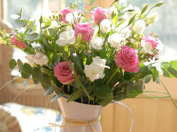 Pink wedding flowers in jug