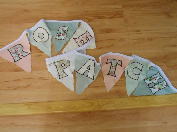"""Our very own sign bunting with the name of our business, """"Rose Patch""""."""
