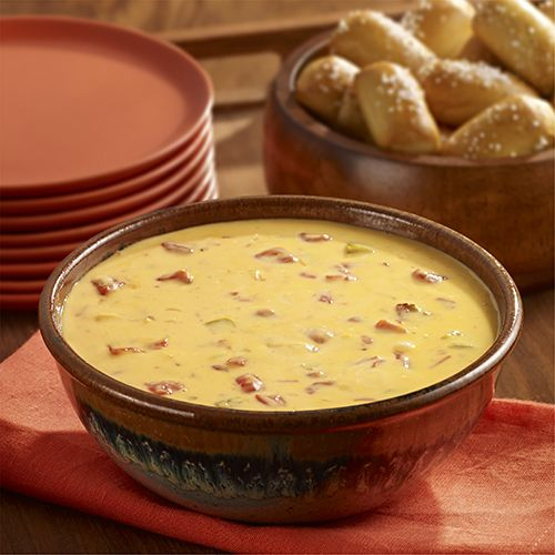 Queso dip recipe adds chopped onion simmered in beer to the classic dip.Velveeta® is a registered trademark of Kraft Foods, Inc.  Ro*Tel® and Parkay® are registered trademarks of ConAgra Foods RDM, Inc.  Budweiser® is a registered trademark of Anheuser-Busch