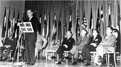 1944 July 8 | Treasury Secretary Henry Morgenthau speaking at the Bretton Woods conference.  Bretton Woods refers to the int'l monetary system adopted in 1944 that established rules for rebuilding the postwar economy. Though WW II was not yet over, 730 delegates from 44 Allied nations attended the conference at the Mt Washington Hotel in Bretton Woods, N.H., to create a new monetary structure among the world's economies. The goal was to avert the economic disasters of the 1930s.
