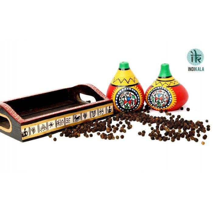 Terracotta Warli Handpainted Salt & Pepper Shaker With Tray  http://www.indikala.com/index.php/featured-products/salt-and-pepper-shaker.html