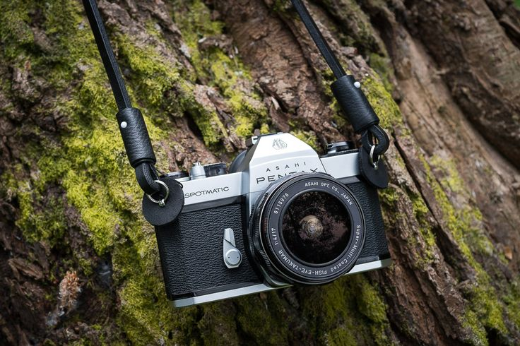 Deadcameras shoulder strap & the Spotmatic. Click the image to see our review of the camera.