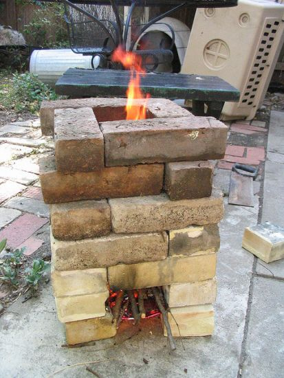 an improvised rocket stove made from brick