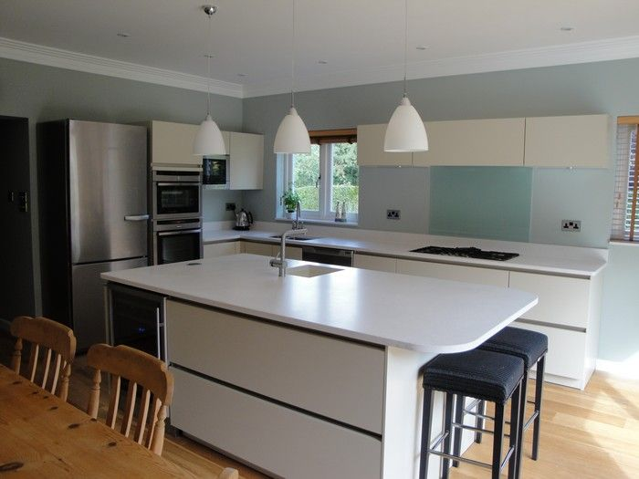 http://www.hogsbackassociates.co.uk/our-works/kitchens-farnham This project, in Farnham, incorporates the SieMatic S2 range of kitchen furniture finished in Amaranth Green with Silestone Blanco Maple worktops. It has a mixture of appliances from Neff, Miele and Elica. 92 The Street, Tongham, Farnham, Surrey, GU10 1AA