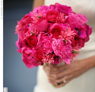 This monochromatic, textural bouquet is full of peonies, roses and ranunculuses.