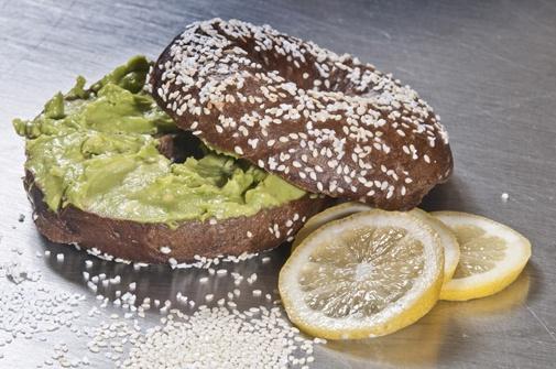 """""""Happiness Bagel""""  Pumpernickel, sesame, salt....mashed avocado:)"""