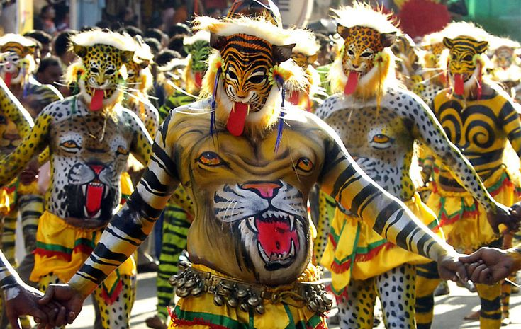 """Kerala, India - Performers dressed as tigers take part in Pulikali, or tiger dance, during festivities in Trichur city, in the southern Indian state of Kerala, September 15, 2008. The ceremony was organised to mark the end of the annual harvest festival, """"Onam"""""""