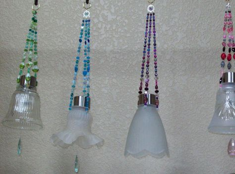 Hanging Solar Lights made from recycled glass light shades with a crystal hanging from them. Cute idea!