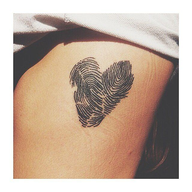 Fingerprint: If you don't want to commit to a handprint or footprint, go with a simple fingerprint, like this one that was shaped into a heart.