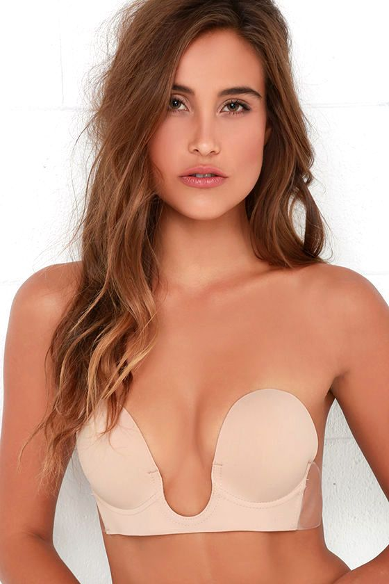 Looking for a bra that you can miraculously wear with a plunging, strapless, and backless dress?! You've come to the right place! The U Plunge Nude Backless Strapless Bra has a deep neckline that lifts as it gives you shape, fastening at your sides with clear adhesive wings, for a barely-there look! Plus, it's reusable: simply hand wash and the adhesive will recharge for your next night out! Sized. Model is wearing a size A. DUE TO THE INTIMATE NATURE OF THIS GARMENT, THIS BRA IS FINAL SALE.