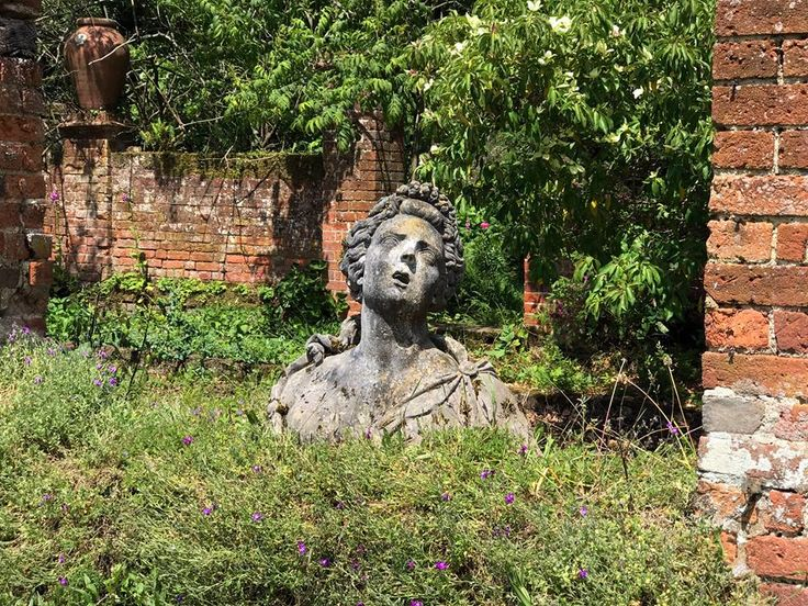 In this secluded area of a still-flourishing, romantic 18th-century garden, the antique statuary has been made beautifully eerie by time and the elements. [All photos © Julia Anne Harris of Nouvo Creative -- thank you!] From the Haunted Garden FB page