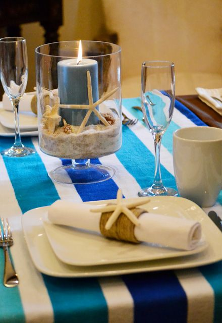 Set a summer beach party theme by using a blue and white-striped beach towel as the tablecloth with BHG White Porcelain dinnerware.
