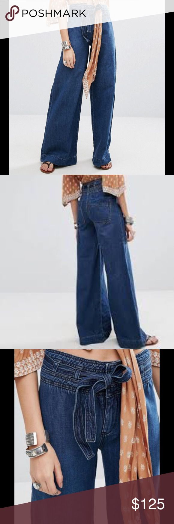 FREE PEOPLE Augusta Jeans Free People mishmash color and prints across an inspired collection of free-flowing maxi dresses, super-soft jersey and leather ankle boots. These amazing jeans feature: Non-stretch denim, High-rise waist, Belt tie, Concealed fly, Functional back pockets, Wide leg, Regular fit - true to size, Machine wash, 100% Cotton Color – Maytal Blue Free People Jeans Flare & Wide Leg