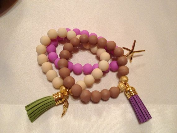 Glass stone rubber effect bracelet with charm and by HappyDonkey, €6.00