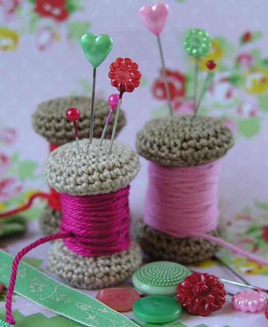 Spool pincushion - free pattern here: http://www.ravelry.com/patterns/library/yarn-spool-pincushion