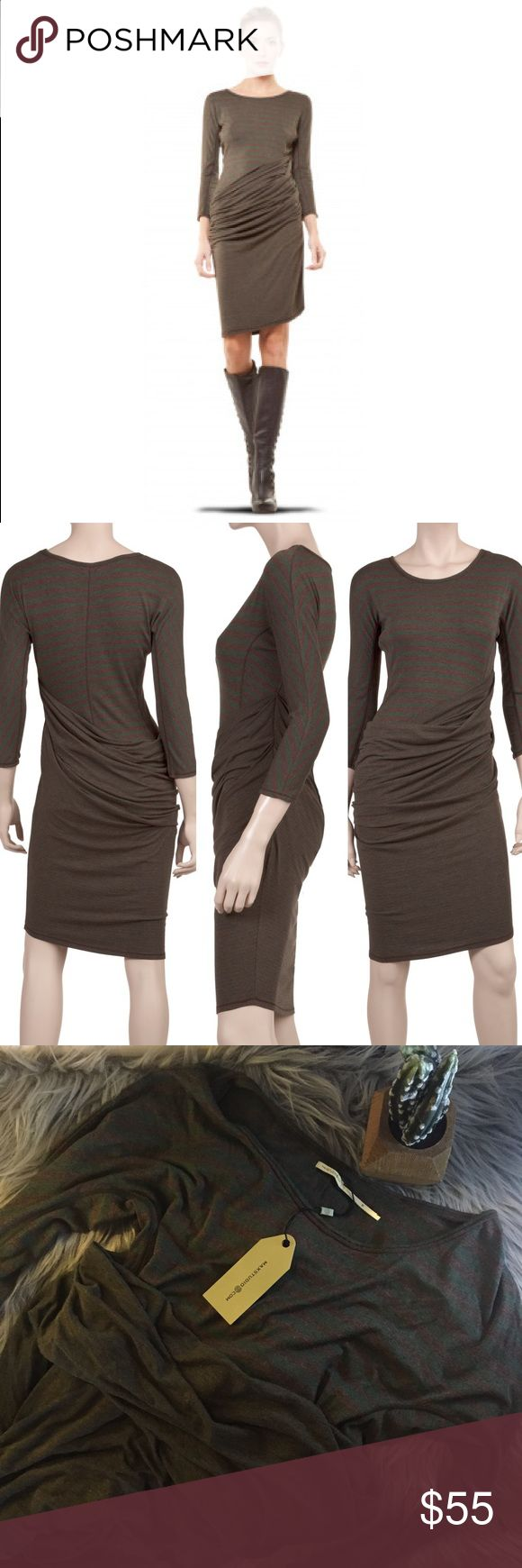 Just in time for F🍁LL Draped Dress Brand NWT body con Maxstudio draped dress. This soft viscose jersey dress is a subtly sexy must-own for desk to dinner glam. Look close at the sleek silhouette and goddess drape across the hips. The bi-striped combination adds extra charm. Wear as a dress with tights and boots or layered over leggings tunic-style. Fits true to size. Maxstudio.  92% VISCOSE, 8% SPANDEX Max Studio Dresses Mini
