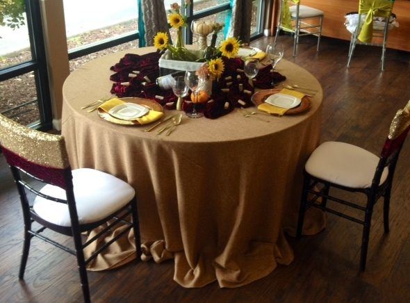 Rustique! Adding a little pop of sequin to the chairs makes this the perfect holiday table. Creative Coverings Specialty Linen Rental and Sales