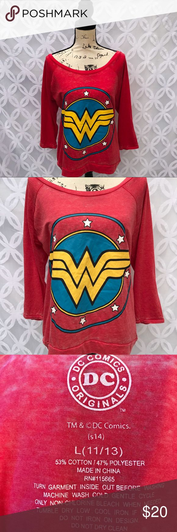 "DC Comics Wonder Woman  Burnout 3/4 Sleeve Tee DC Comics Wonder Woman  Burnout 3/4 Sleeve Tee NWOT.       Measurements Laying Flat Size 🔹 L or XXL Armpit to Armpit 🔹L 21"" XXL  23"" Shoulder to Bottom🔹27"" XXL 28"" Bundle to Save 🤓 Sorry NO outside transactions 🚫 Reasonable Offers welcomed 👍 NO Low balling 👎 NO modeling 👎 All items from a pet 😼and Smoke Free Home  Happy Poshing 🤗 Wonder Woman Tops Tees - Long Sleeve"