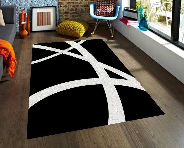 Black and White Rug. Strong design, simple shapes, truly impact in your decoration. This modern rug combines with any colors so you can add it to any room in your home. In TheGretest we offer you our