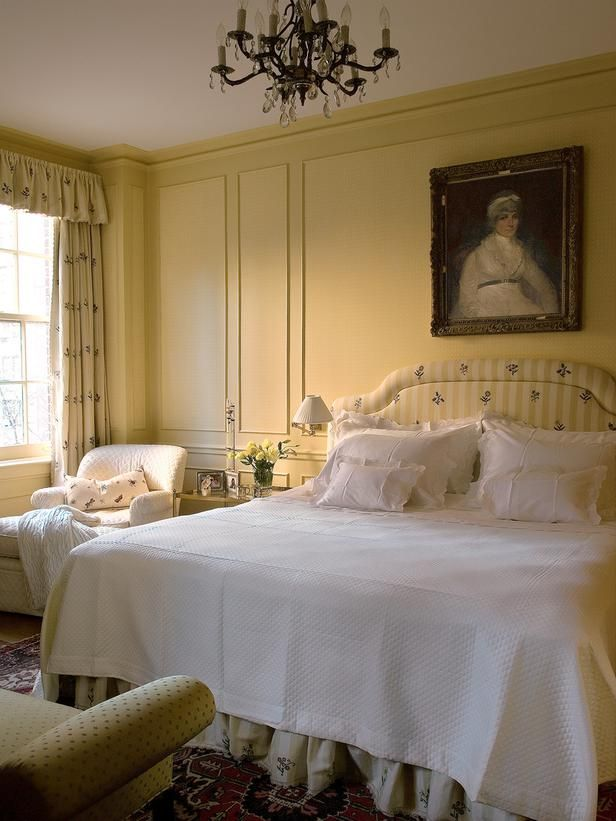 Traditional Bedroom With Cheery Yellow Walls and Coordinating Headboard and Curtains - on HGTV