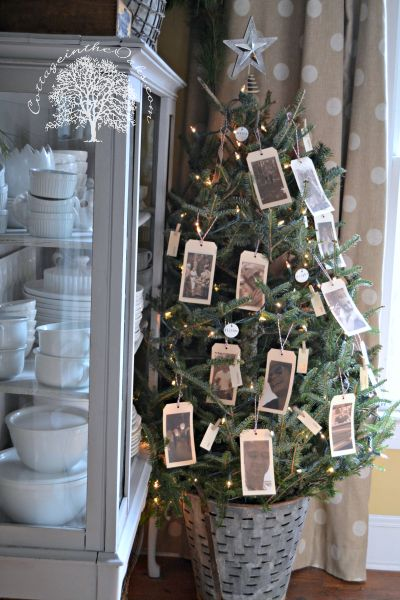 Tree with hang tag photos of the past year's memories!